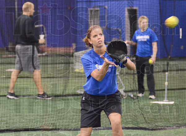Incoming: Indiana State third baseman Megan Stone catches an incoming throw from teammate Makenzie Connelly during Friday's softball team practice.