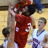 Tribune-Star/Jim Avelis<br /> Heavy traffic: Terre Haute South's Jermaine Smith drives the lane against the defense of Martinsville's Greg Spina(42) and Noah Davis(24).