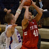 Tribune-Star/Jim Avelis<br /> High pressure system: Terre Haute South senior Jeffrey Turner gets off a shot past the reach of Martinsville forward Jason Ray.