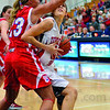 Tribune-Star/Joseph C. Garza<br /> And, one...eye: Terre Haute South's Tasia Brewer is fouled by Plainfield's Kasey Johnson as she drives to the basket during the Braves' sectional game against the Quakers Tuesday at North.
