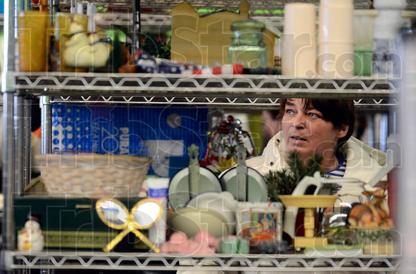 Tribune-Star/Joseph C. Garza<br /> Bargain hunter: Goodwill Store shopper Sylvia Hall carefully looks over shelves of goods to purchase at the new store at 2645 Wabash Avenue Tuesday.
