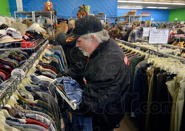 Tribune-Star/Joseph C. Garza<br /> A good buy in hand: Thomas Simmons found what he was looking for as he was one of the first shoppers to visit the new Goodwill store Tuesday at 2645 Wabash Avenue.