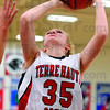 Tribune-Star/Joseph C. Garza<br /> Big points and big boards: Terre Haute South's Hannah Lee drives to the basket against the Plainfield defense during the Braves' upset of the Quakers in the Terre Haute North sectional.