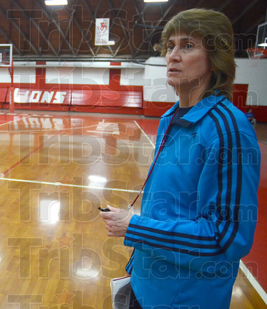 Tribune-Star/Jim Avelis<br /> Coach: Kathy Miller watches over her Marshall High School girl's basketball team during practice Monday afternoon.