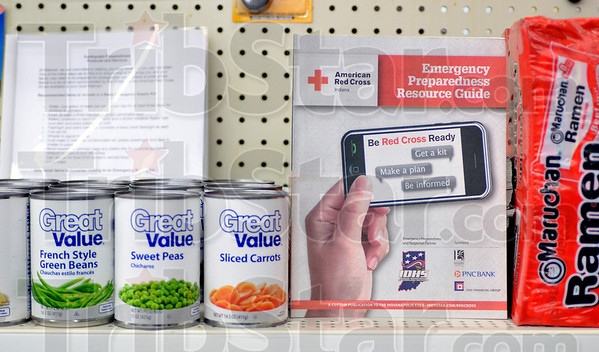 Tribune-Star/Joseph C. Garza<br /> Emergency Guide with a side of carrots: An American Red Cross Emergency Preparedness Guide sits between sliced carrots and Ramen noodles on an aisle end cap dedicated to emergency supplies at the Clinton Walmart.