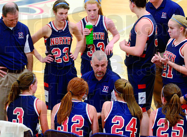 Tribune-Star/Joseph C. Garza<br /> Game plan: Terre Haute North coach Mike Allen talks to his team during a time-out in the Patriots' sectional game against Northview Tuesday at North.