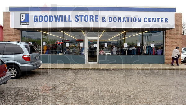 """Tribune-Star/Joseph C. Garza<br /> The """"open"""" sign is on: Bargain hunters have a new opportunity to save with the opening of the new Goodwill Store & Donation Center at 2645 Wabash Avenue."""