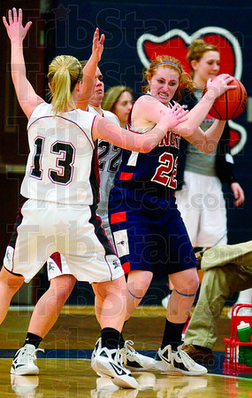 Tribune-Star/Joseph C. Garza<br /> Keep away: Terre Haute North's Elizabeth Harris tries to keep the ball away from Northview's Whitney Halfhill (13) and Abbey Timberman during the Patriots' sectional game against the Knights Tuesday at North.