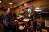 "Gloria Rubio Cortes (Mile High United Way board of directors member) gets a pancake topped with special sauce by Jon Schlegel of Snooze.  ""Seventh Annual PJ Day,"" benefiting Denver's Road Home, at the Residence Inn Denver City Center in Denver, Colorado, on Thursday, Feb. 9, 2012.<br /> Photo Steve Peterson"