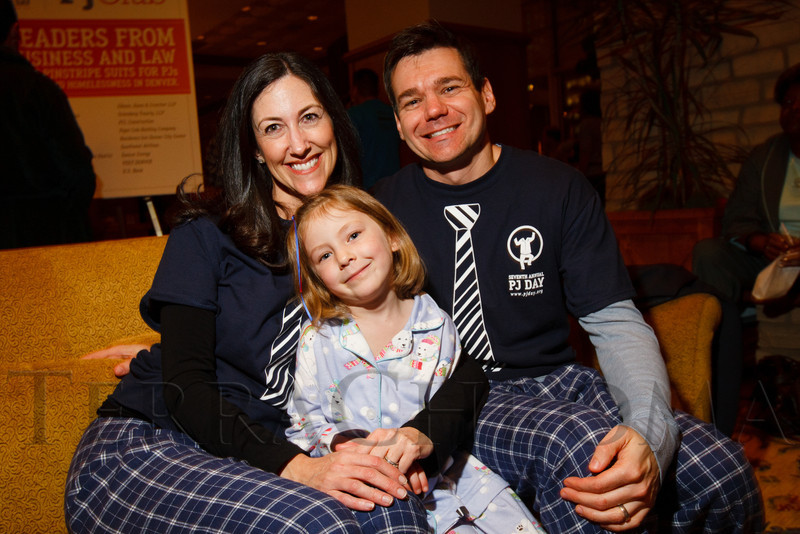 """Jessica, Chris, and Hadley (5-1/2 years old) Brown.  """"Seventh Annual PJ Day,"""" benefiting Denver's Road Home, at the Residence Inn Denver City Center in Denver, Colorado, on Thursday, Feb. 9, 2012.<br /> Photo Steve Peterson"""