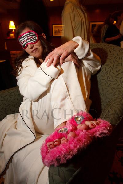"""Lisha Burnett (Suncor Energy) models her recent pedicure and her daughter's sleep mask.  """"Seventh Annual PJ Day,"""" benefiting Denver's Road Home, at the Residence Inn Denver City Center in Denver, Colorado, on Thursday, Feb. 9, 2012.<br /> Photo Steve Peterson"""