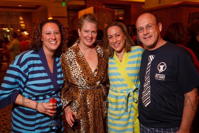 "Corey Plotkin, Joyce Witte (Encana), Sarah Hogan, and Doug Hock (Encana).  ""Seventh Annual PJ Day,"" benefiting Denver's Road Home, at the Residence Inn Denver City Center in Denver, Colorado, on Thursday, Feb. 9, 2012.<br /> Photo Steve Peterson"