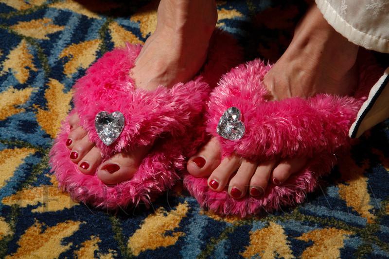 """Lisha Burnett models her slippers.  """"Seventh Annual PJ Day,"""" benefiting Denver's Road Home, at the Residence Inn Denver City Center in Denver, Colorado, on Thursday, Feb. 9, 2012.<br /> Photo Steve Peterson"""