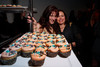 "Valerie Byrnes and Theresa Yaquoob, with ""Cuppy Cakes,"" serving at the event.  Design After Dark 2012, themed ""bespoke,"" benefiting the Denver Art Museum, at 445 Broadway in Denver, Colorado, on Friday, Feb. 10, 2012.<br /> Photo Steve Peterson"