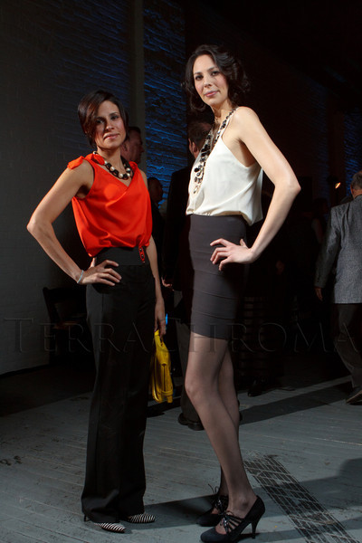 "Brit Gillcomacchio and Genevieve Hicks, in an outfit designed by her sister, Dominique Hicks, with BCBG Max Azria in Los Angeles.  Design After Dark 2012, themed ""bespoke,"" benefiting the Denver Art Museum, at 445 Broadway in Denver, Colorado, on Friday, Feb. 10, 2012.<br /> Photo Steve Peterson"