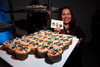 "Theresa Yaquoob, with ""Cuppy Cakes,"" serving at the event.  Design After Dark 2012, themed ""bespoke,"" benefiting the Denver Art Museum, at 445 Broadway in Denver, Colorado, on Friday, Feb. 10, 2012.<br /> Photo Steve Peterson"