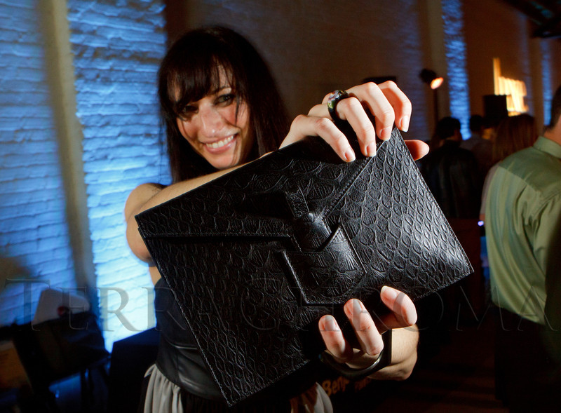 "Stacey Rosenberg, wearing H&M, but carries an Yves Saint Laurent bag, ready for the upcoming DAM YSL exhibit party.  Design After Dark 2012, themed ""bespoke,"" benefiting the Denver Art Museum, at 445 Broadway in Denver, Colorado, on Friday, Feb. 10, 2012.<br /> Photo Steve Peterson"