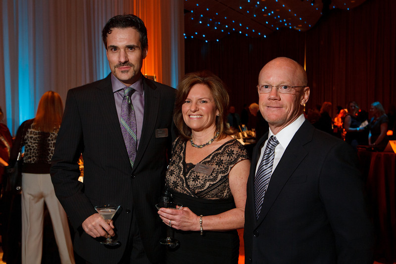 """Marco Chayet with Emily and Mark Spencer.  Benefit for InnovAge, formerly Total Community Options Foundation, themed, """"Early Bird Special,"""" at the Donald R. Seawell Grand Ballroom, Denver Center for Performing Arts, in Denver, Colorado, on Saturday, Feb. 18, 2012.<br /> Photo Steve Peterson"""