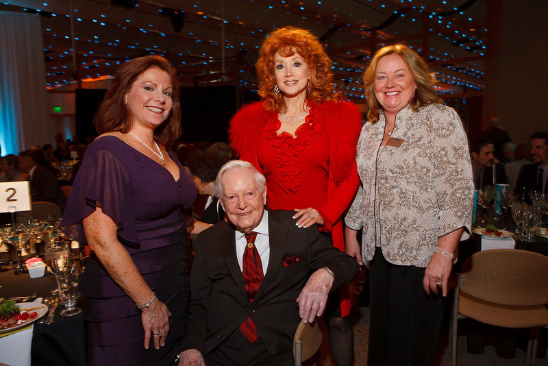"""Leslie Karotkin, Donald Seawell, Judi Wolf, and Maureen Hewitt.  Benefit for InnovAge, formerly Total Community Options Foundation, themed, """"Early Bird Special,"""" at the Donald R. Seawell Grand Ballroom, Denver Center for Performing Arts, in Denver, Colorado, on Saturday, Feb. 18, 2012.<br /> Photo Steve Peterson"""