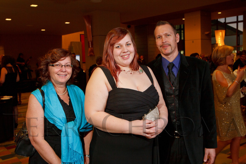 Josie Krammes (center, who gave a testimonial onstage), with parents, Jessica and Richard.  Excelsior Youth Center gala at the Hyatt Regency Denver at the Colorado Convention Center in Denver, Colorado, on Friday, Feb. 24, 2012.<br /> Photo Steve Peterson
