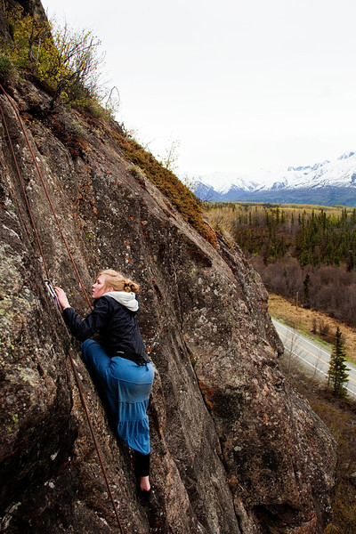 Megan explores the moves for her first time out on the rocks, climbing <i>Red Road 5.9</i>.