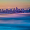 I just loved the smooth fog under the city and had to zoom in closer