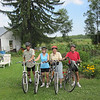 """SCHMIDTS AND PETERSONS BICYCLED UP TO KENNAN, WISCONSIN...ONE FEED MILL, ONE TAVERN (CLOSED), AND ONE TINY SPORTING GOOD STORE BUT 5 CHURCHES!!! (NO ICE CREAM TO BE BOUGHT ANYWHERE...AND DOUG HAD """"PROMISED"""")"""