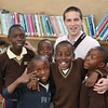 Sam goofing with kids in the library that the Zambia Club built.