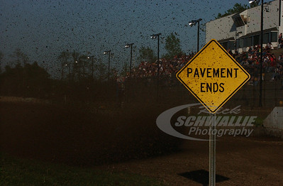 Jared Landers passes the entrance to the speedway where the pavement ends
