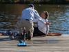 Bill greets Joan as she docks