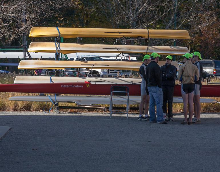 Boys Varsity Four with Coach Matt and borrowed boat at CRI