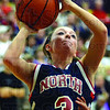 Tribune-Star/Jim Avelis<br /> All eyes: Morgan Seeley eyes the hoop against a tight Sullivan defense.