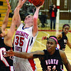 Tribune-Star/Jim Avelis<br /> Heavy traffic: Terre Haute South center Hannah Lee gets heavy pressure as she scores inside against the defense of North Central's Jasmine Falcon(10) and Nariah Taylor(54).