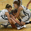 Tribune-Star/Jim Avelis<br /> All wrapped up: West Vigo's McKenzie Little and Shyanne Elkins sandwich Shakamak's Megan Phipps as they scramble for control of the ball in first half action Thursday night in the Viking's gym.