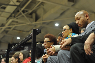 The family of Ariane Patterson, her father Aaron Patterson, sister Rochell, and mother Connie, praying together in the LYCC at noon January 20, 2012