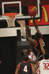 Stefon Johnson, 5, attempts to block Campbell's shot.