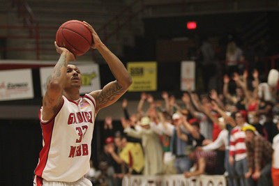 Tashan Newsome, 32, shoots the free throw with the Holtmaniacs supporting him.