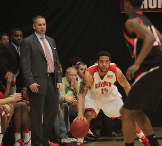 Head coach Chris Holtmann watches as Laron Buggs, 15, takes the ball up the court.