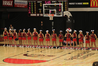 The cheerleaders singing the National Anthem.