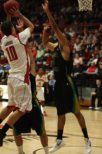 Max Landis, 10, shoots the ball