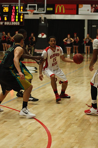Laron Buggs, 15, dribbles the ball