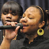 Soloist: Melanie Wright sings a solo during the Martin Luther King Jr. Commemoration Dinner Friday night.