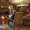 Super serenity:Central Minnesota resident Deb Tamm sits by the fire in the Turkey Run Inn.  The Inn is offering rooms to Super Bowl fans unable to get lodging in Indianapolis.
