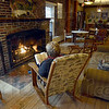 Inviting: Central Minnesota resident Deb Tamm reads a book in front of the fireplace at the Turkey Run Inn Friday afternoon. The facility is available for Super Bowl fans that can't locate lodging.