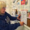 Tribune-Star/Jim Avelis<br /> Here to help: Dottye Crippen, program director for Bethany House, posts a flyer on the diningroom bulliten board. With the homeless count coming up this week, efforts are being made to ensure an accurate total.