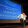 First coat: Joshua Michael Allen receives his white coat during the White Coat Ceremony at University Hall Sunday.