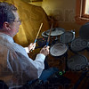 Gettin' down: George Richardson gives his set of electric drums a workout Sunday afternoon at his eastside residence.