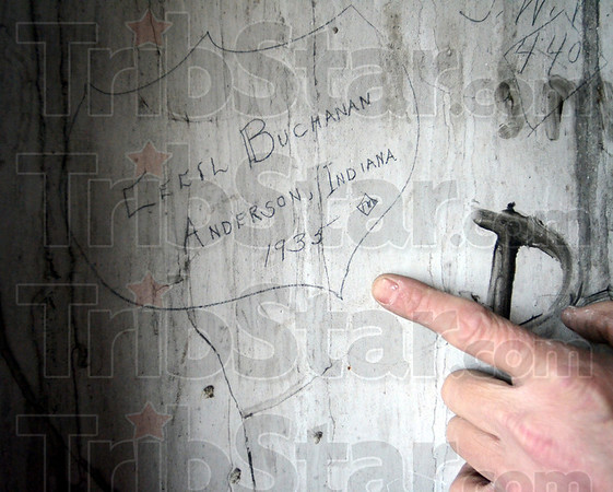 Grafitti: The elevator shaft in the Davis Building is signed with dozens of names dating back to the early 1900's. Cecil Buchanan's 1935 signature is still very visible.