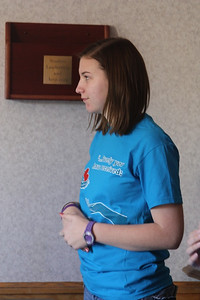 A CMU Student helps out during the t-shirt exchange on Wednesday, Janurary 25th