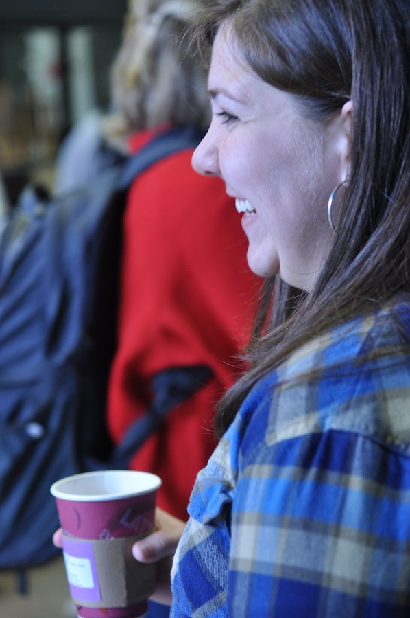 CMU member, Summer Baliles, give out coffee to students in the LYCC concourse on their way into dimensions Tuesday January 24, 2012 .
